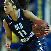 Lady Monarchs Guard Ashley Betz-White #11 attempts to pass the ball during a Colonial Athletic Association game against Delaware