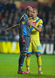 SWANSEA, WALES - Thursday, February 20, 2014: SSC Napoli's goalkeeper Pepe Reina and Gokhan Inler during the UEFA Europa League Round of 32 1st Leg match against Swansea City at the Liberty Stadium. (Pic by David Rawcliffe/Propaganda)