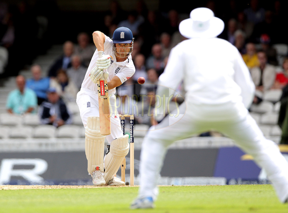 © Andrew Fosker / Seconds Left Images 2012 - England's Alastair Cook pushes the ball to South Africa's Hashim Amla (R) at mid-off - England v South Africa - 1st Investec Test Match -  Day 1 - The Oval  - London - 19/07/2012