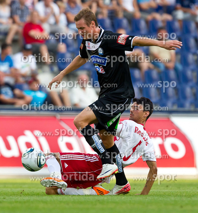 21.08.2011, Red Bull Arena, Salzburg, AUT, 1. FBL, Red Bull Salzburg vs Sturm Graz, im Bild Roman Kienast, (Sturm Graz, #24) vs Chema Anton  (Red Bull Salzburg, #5) // during the Austrian Bundesliga Match, Red Bull Salzburg vs Sk Sturm Graz, Red Bull Arena, Salzburg, 2011-08-21, EXPA Pictures © 2011, PhotoCredit: EXPA/ J. Feichter