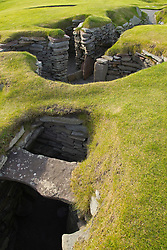 Iron Age Pub.  <br /> UK SCOTLAND Jarlshof -- 23 Aug 2011 -- One of the best examples of an Pictish 'wheelhouse' at the Jarlshof site near Sumburgh Head in the Shetland Islands of Scotland. This wheelhouse appears to have been part of a very large and complex Broch and is part of a mixed archaeological site which is thought to cover a period of sporadic habitation from 2500 BC to the 16th Century (the Laird's House visible as a ruin on the top right of this picture). The site also has Bronze and Iron Age buildings and Viking structures. The Bronze and Iron Age structures appear to be a larger, more complex building which was likely used as a sort of pub of it's day. *NB These images are attached to a story on the Iron Age Site.<br /> 23rd August 2011. Picture by Jonathan Mitchell / i-Images.