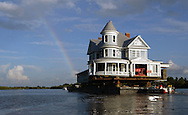 A 7,000 square foot Victorian mansion was moved by barge from Bradenton, Florida to Ruskin, Florida.  The 25 mile voyage ended with a rainbow seemingly leading the way home.