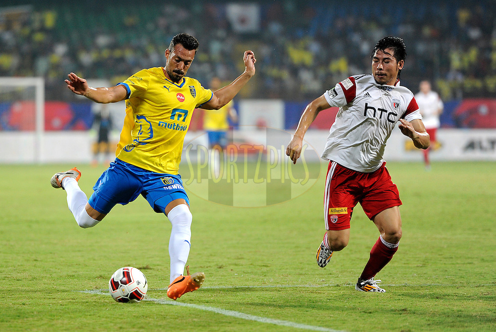 Victor Herrero Forcada of Kerala Blasters FC and Robin Gurung of NorthEast United FC during match 49 of the Hero Indian Super League between Kerala Blasters FC and North East United FC held at the Jawaharlal Nehru Stadium, Kochi, India on the 30th November.<br /> <br /> Photo by:  Pal Pillai/ ISL/ SPORTZPICS
