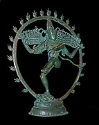 Bronze figure of NatarajaFrom Tamil Nadu, southern India. Chola dynasty, around AD 1100. Dancing Shiva in a ring of fire. The Hindu god Shiva as lord of the dance, Nataraja, in a ring of fire. His long ascetic's hair flies out on either side of his head as he performs his dance. Shiva as Nataraja appears at the end of one cosmic cycle and the beginning of the next, and is thus associated with both creation and destruction. In his hands he holds both the destructive fire and the double-sided drum, the sound from which summons