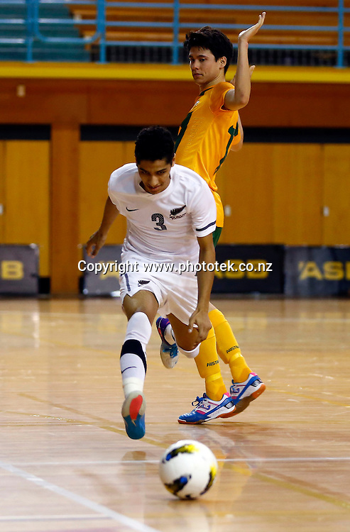 Futsal Whites Dylan Manickum is taken out. ASB Trans Tasman Cup, Futsal Whites v Futsal Roos, ASB Stadium, Kohimarama, Friday 21st September 2012. Photo: Shane Wenzlick