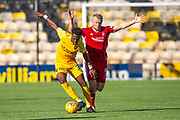 Steve Lawson (#33) of Livingston FC shields the ball from Curtis Main (#9) of Aberdeen FC during the Ladbrokes Scottish Premiership match between Livingston FC and Aberdeen FC at The Tony Macaroni Arena, Livingston, Scotland on 21 September 2019.