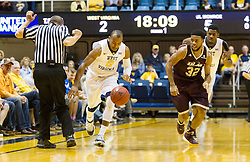 Dec 13, 2015; Morgantown, WV, USA; West Virginia Mountaineers guard Jevon Carter (2) steals the ball from Louisiana Monroe Warhawks guard Justin Roberson (32) during the first half at WVU Coliseum. Mandatory Credit: Ben Queen-USA TODAY Sports