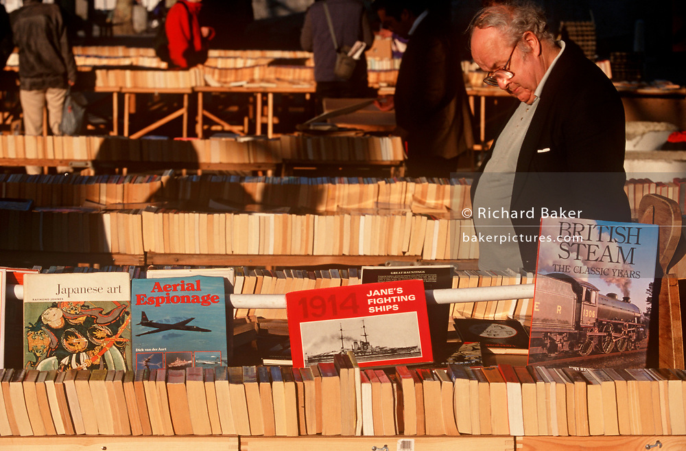 A book-lover browses titles and editions under Waterloo Bridge on the Southbank, on 18th February 2000, in London, England. (Photo by Richard Baker / In Pictures via Getty Images)