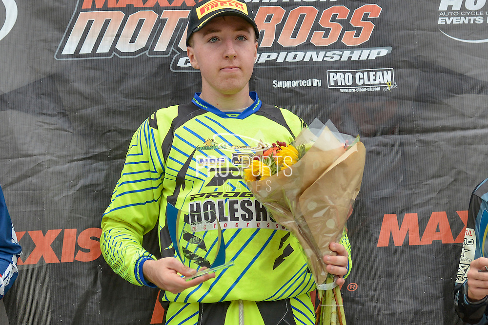 James Carpenter (184) of Holeshot Motocross takes first prize for MXY2 at the Maxxis Acu British Motocross Championship at Foxhill Moto Park, Swindon, United Kingdom on 18 September 2016. Photo by Mark Davies.