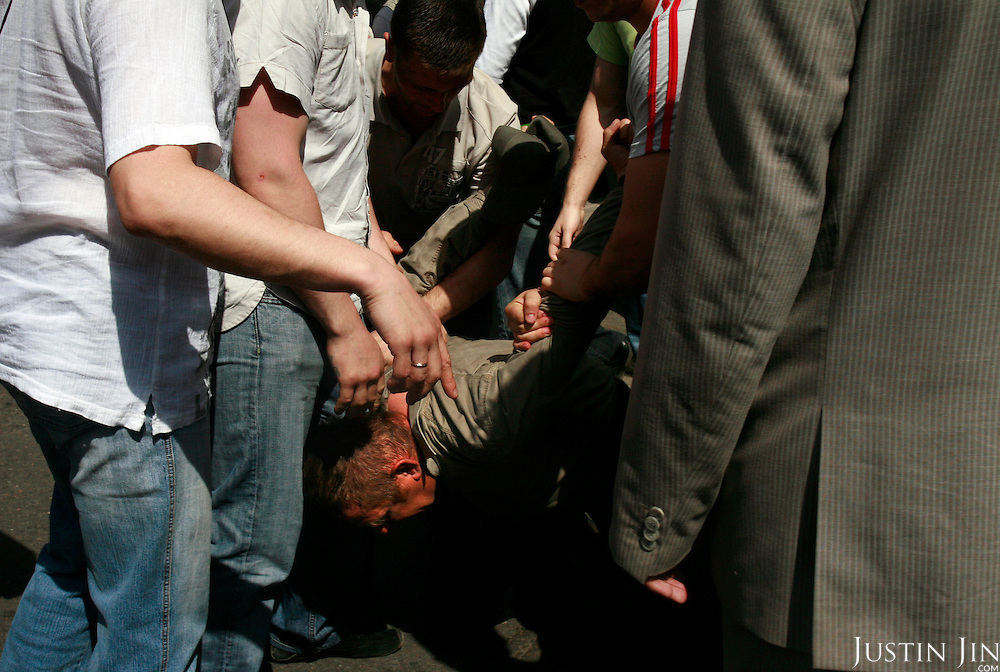 Plain-cloth police arrest a violent nationalist after he attacked gay activists. Authorities, nationalist protesters and Orthodox Christians forcefully prevented gay and lesbian rights activists from rallying in Moscow..Homosexuality was decriminalized in Russia in 1993. Moscow has repeatedly banned gay parades, including this one. .