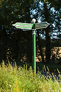 Signpost pointing to Rozel Harbour, St Martins and Trinity Church in Jersey, Channel Isles