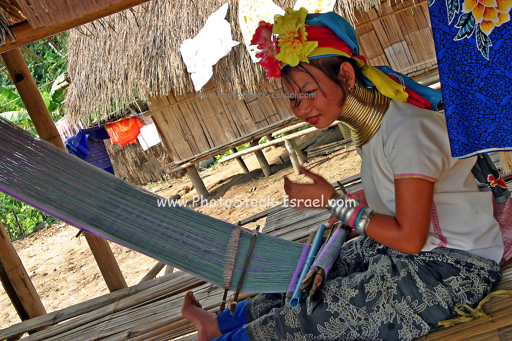 Padaung Karen woman weaving with traditional hand loom Chiang Mai Province, Thailand