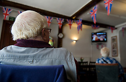 LOCATION, UK  29/04/2011. The Royal Wedding of HRH Prince William to Kate Middleton. ..Drinkers enjoy the occasion on TV as they watch from the Conservative Club in Marlborough.....Photo credit should read Ian Forsyth/LNP. Please see special instructions. © under license to London News Pictures