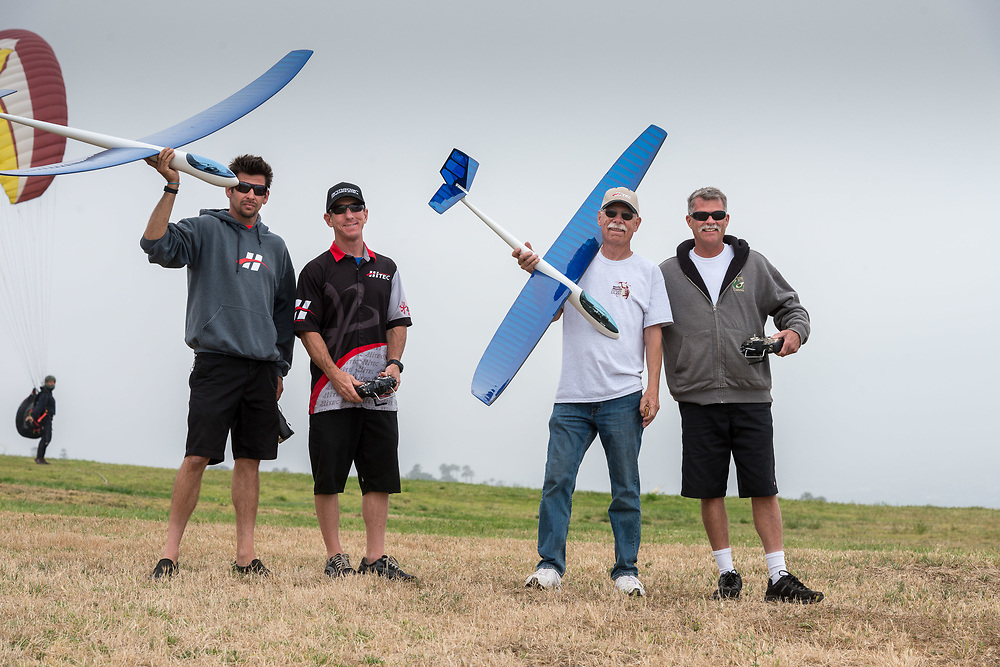 L to R  Holding the Superhawk is Paul Anderson, next to him holding a transmitter is Gregg Bolton who flew the Katie Special Superhawk....next is Bob Martin holding Katie's original Hobie Hawk with her ashes epoxied into the nose and Brent Daly holding the transmitter. He flew the original Hobie Hawk.