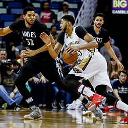 Mar 19, 2017; New Orleans, LA, USA; New Orleans Pelicans forward Anthony Davis (23) drives past Minnesota Timberwolves center Karl-Anthony Towns (32) during the first quarter of a game at the Smoothie King Center. Mandatory Credit: Derick E. Hingle-USA TODAY Sports