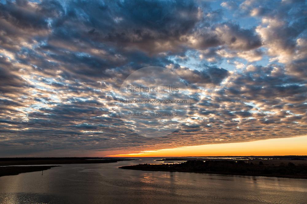 Sunrise over the Edisto River and marsh in Edisto Island, South Carolina.