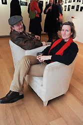 DAVID LICHFIELD and his wife CAROLINE at a private view of photographs by Nick Ashley held at the Sladmore Gallery, 32 Bruton Place, London on 13th January 2010.
