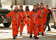 Space Shuttle Discovery launch, STS-121..Discovery's crew waves American flags on their way into the Astrovan to be taken to launch pad 39B on Independence day, July 4, 2006.