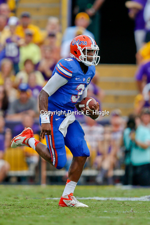 Oct 12, 2013; Baton Rouge, LA, USA; Florida Gators quarterback Tyler Murphy (3) against the LSU Tigers during the second half of a game at Tiger Stadium. LSU defeated Florida 17-6. Mandatory Credit: Derick E. Hingle-USA TODAY Sports