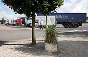 An HGV lorry driver returns to his lorry after a break at the M40 motorway services in Warwickshire, England.