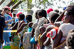 BEIRA, March 29, 2019  People wait to receive health examination or medical treatment from the Chinese rescue team at a resettlement site for victims of Cyclone Idai, about 70 kilometers from Beira, Mozambique, March 27, 2019. The Chinese rescue team has been delivering humanitarian aid in central Mozambique since Monday after Cyclone Idai wreaked havoc in the southeastern African country. (Credit Image: © Xinhua via ZUMA Wire)