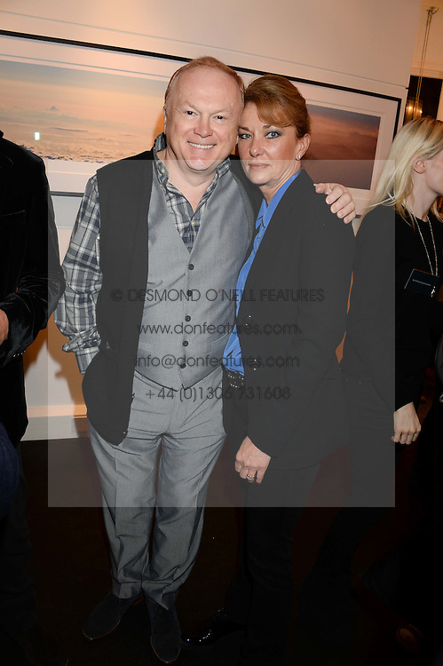 Song writer MIKE BATT and his wife JULIANNE at a private view of Photographs by Julian Lennon held at The Little Black Gallery, 13A Park Walk, London SW10 on 17th September 2013.