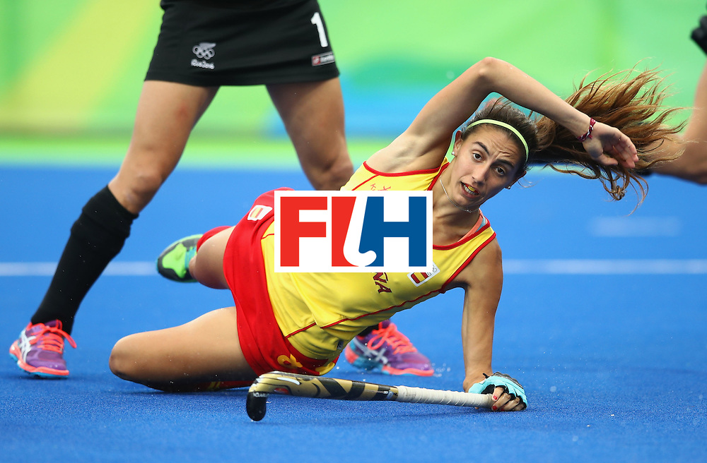RIO DE JANEIRO, BRAZIL - AUGUST 10:  Carola Salvatella of Spain falls under a challenge during the Women's Pool A Match between Spain and New Zealand on Day 5 of the Rio 2016 Olympic Games at the Olympic Hockey Centre on August 10, 2016 in Rio de Janeiro, Brazil.  (Photo by Mark Kolbe/Getty Images)