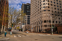 An individual stands adjacent to a very vacant First Avenue, devoid of its typical traffic for several city blocks. (April 4, 2020).