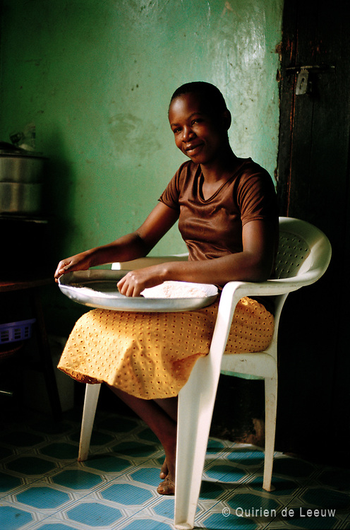 Girl preparing ugali, Uganda.<br /> 35mm film