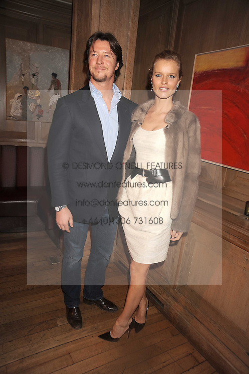 EVA HERZIGOVA and GREGORIO MARSIAJ at a party to celebrate the launch of Hollywood Domino - a brand new board game, held at Mosimann's 11b West Halkin Street, London on 7th November 2008.  The evening was in aid of Charlize Theron's Africa Outreach Project.