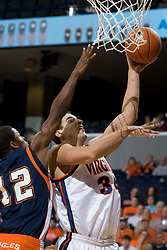 Virginia Cavaliers F/C Ryan Pettinella (34) shoots around Carson-Newman Eagles G Andrew Johnson (12).  The Virginia Cavaliers men's basketball team defeated the Carson-Newman Eagles 124-65 in an exhibition basketball game at the John Paul Jones Arena in Charlottesville, VA on November 4, 2007.