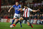Eastleigh Midfielder, Sam Togwell (14) and Brentford Defender, John Egan (14) during the The FA Cup 3rd round match between Brentford and Eastleigh at Griffin Park, London, England on 7 January 2017. Photo by Adam Rivers.
