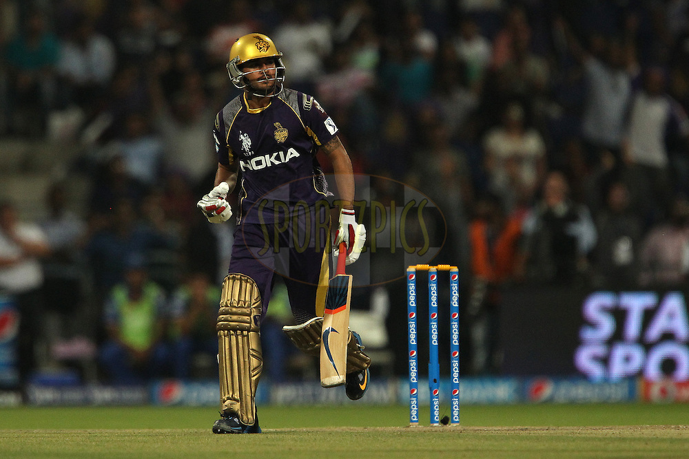 Manish Pandey of the Kolkata Knight Riders celebrates after hitting a six during the SUPER over in match 19 of the Pepsi Indian Premier League 2014 Season between The Kolkata Knight Riders and the Rajasthan Royals held at the Sheikh Zayed Stadium, Abu Dhabi, United Arab Emirates on the 29th April 2014<br /> <br /> Photo by Ron Gaunt / IPL / SPORTZPICS