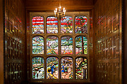 Glass windows (not stained glass) in the Great Hall of 2 Temple Place, on 17th September 2017, in London, England. As an example of a late Victorian mansion, it was built for William Waldorf Astor primarily as his state office by one of the foremost neo-Gothic architects of the late nineteenth-century, John Loughborough Pearson. Astor had emigrated to England in 1891 as arguably, the richest man in the world and no expense was spared when work began on Two Temple Place in 1892. Today, the building is owned by the Bulldog Trust and supports the charitable activities of the Trust through exhibitions and events hosted in the building.