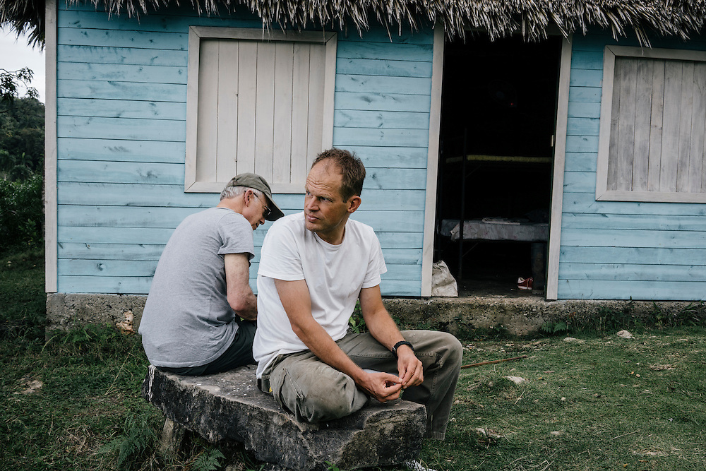 Ornithologists Martjan Lammertink and Tim Gallagher, wait at a campsite at Taco Bay, a tourist area on the coastline of Eastern Cuba, while he and Martjan Lammertink waited for the permit to Humbolt National Park to be accepted on Jan. 26, 2016.