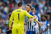 Nick Pope (GK) (Burnley) & Dale Stephens (Brighton) hug following the Premier League match between Brighton and Hove Albion and Burnley at the American Express Community Stadium, Brighton and Hove, England on 14 September 2019.