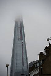 © London News Pictures. 29/04/2012. London, UK. The top of The Shard covered by low cloud during heavy rainfall in London  on April 29, 2012 . Photo credit : Ben Cawthra /LNP