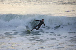 May 6, 2019 - Christchurch, New Zealand - A surfer loses his balance as he rides a wave at New Brighton Beach in Christchurch, New Zealand on May 05, 2019. (Credit Image: © Sanka Vidanagama/NurPhoto via ZUMA Press)