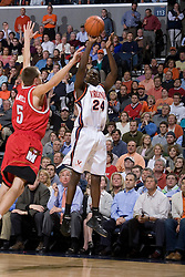 Virginia's Mamadi Diane (24) shoots over Maryland's Eric Hayes (5).  The Cavaliers defeated the #22 ranked Terrapins 103-91 at the John Paul Jones Arena in Charlottesville, VA on January 16, 2007.