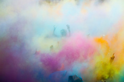 Image ©Licensed to i-Images Picture Agency. 02/08/2014. London, United Kingdom.Festival Goers get stuck into the  powder drop at the Holi One Festival of Colours taking place at Wembly Park, London. Picture by i-Images