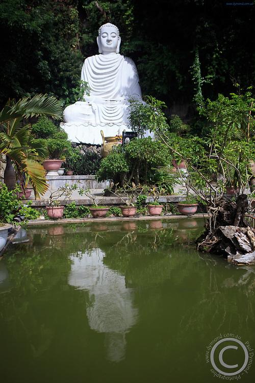 A giant Buddha statue in the gardens of Thuy Son Mountain, Da Nang, Vietnam
