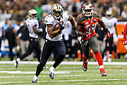 NEW ORLEANS, LA - SEPTEMBER 20:  Marques Colston #12 of the New Orleans Saints runs the ball after catching a pass during a game against the Tampa Bay Buccaneers at Mercedes-Benz Superdome on September 20, 2015 in New Orleans Louisiana.  The Buccaneers defeated the Saints 26-19.  (Photo by Wesley Hitt/Getty Images) *** Local Caption *** Marques Colston