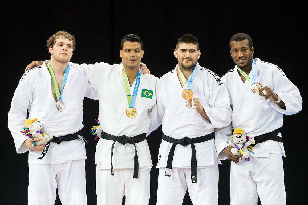 Luciano Correa (2nd left) of Brazil is joined by (L-R) silver medalist Marc Deschenes of Canada, bronze medalists  Hector Campos of Argentina and  Jose Armenteros of Cuba during the medal ceremony for the mens judo -100kg class at the 2015 Pan American Games in Toronto, Canada, July 14,  2015.  AFP PHOTO/GEOFF ROBINS