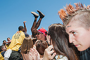 SAN DIEGO, CA - Fans crowd surf at the Vans Warped Tour, which stopped in San Diego, California during the first week of its final run, June 22, 2018.