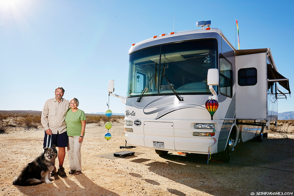 Hector and Brenda Lopez stand outside their Class A motorhome while camping in the Anza Borrego desert of California.