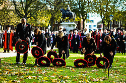 Poppy wreaths are laid during a Remembrance Sunday service in Queen's Square, Bristol, held in tribute for members of the armed forces who have died in major conflicts.
