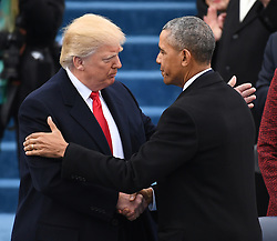January 20, 2017 - Washington, District of Columbia, U.S. - President DONALD TRUMP shakes hands with ex-President BARACK OBAMA after he took the oath of office at the Inauguration Ceremony.  Trump became the 45th President of the United States.  (Credit Image: © Pat Benic/CNP via ZUMA Wire)