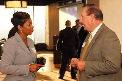 (from left) Natasha Bryant of Office Depot Business Solutions Division, Chad Hooper of Quintessential Advisors, Ltd, George Trumbull of TSF5 Corporation and Dennis Swearingen of Sequent during the Dayton Area Chamber of Commerce Breakfast Briefing at the Dayton Racquet Club in downtown Dayton, Friday, July 13, 2012.