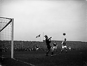 17/03/1960<br /> 03/17/1960<br /> 17 March 1960<br /> Soccer: League of Ireland v Hessen Football Association at Dalymount Park, Dublin.<br /> Hessian Goalie Leichum punches away this shot watched by Kaufhold (right) and Hamilton (Ireland).