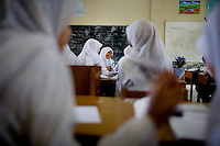 Students study at a state Islamic boarding school, which offers both national and Islamic curriculum, in Banda Aceh, Indonesia, on Tuesday, Nov. 10, 2009. The Islamic curriculum also teaches arabic language.